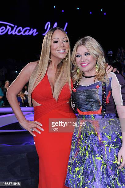 Judge Mariah Carey and singer Kelly Clarkson at FOX's American Idol Season 12 Top 6 To 5 Live Elimination Show on April 11 2013 in Hollywood...