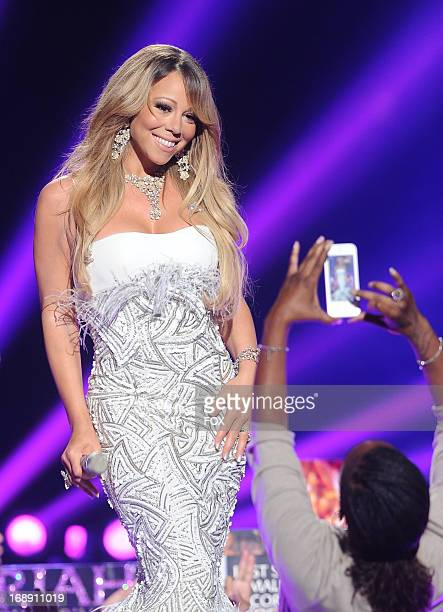 Judge Mariah Carey performs onstage at FOX's 'American Idol' Season 12 Live Finale Show at Nokia Theatre LA Live on May 16 2013 in Los Angeles...