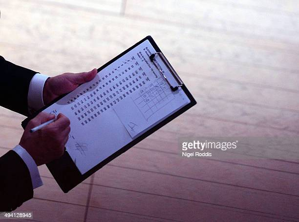 A judge marks his scorecard during the British Amateur Open Dance Championships at the Winter Gardens on May 27 2014 in Blackpool England Couples...