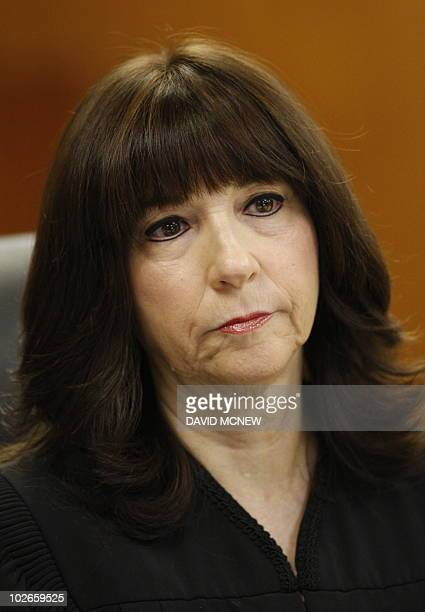 Judge Marsha Revel listens to actress Lindsay Lohan and her lawyer Shawn Chapman Holley during her hearing at the Beverly Hills Courthouse on July 6...