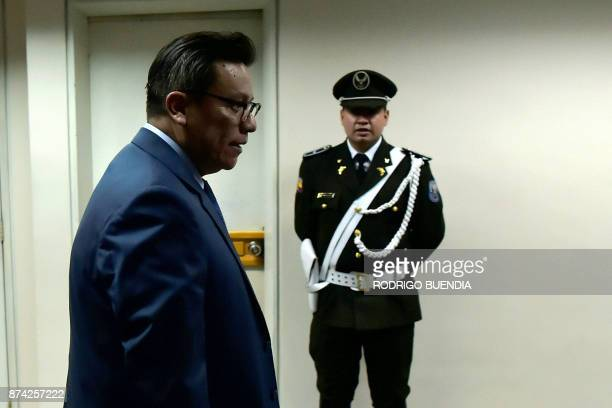 Judge Miguel Jurado enters the courtroom for a pretrial hearing for VicePresident Jorge Glas in the National Court in Quito Ecuador on November 14...