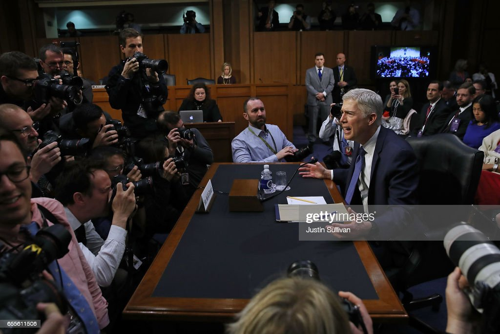 Judge Neil Gorsuch asks photographers, 'Is this what you do all day? I'm sorry,' after he arrived for the first day of his Supreme Court confirmation hearing before the Senate Judiciary Committee in the Hart Senate Office Building on Capitol Hill March 20, 2017 in Washington, DC. Gorsuch was nominated by President Donald Trump to fill the vacancy left on the court by the February 2016 death of Associate Justice Antonin Scalia.