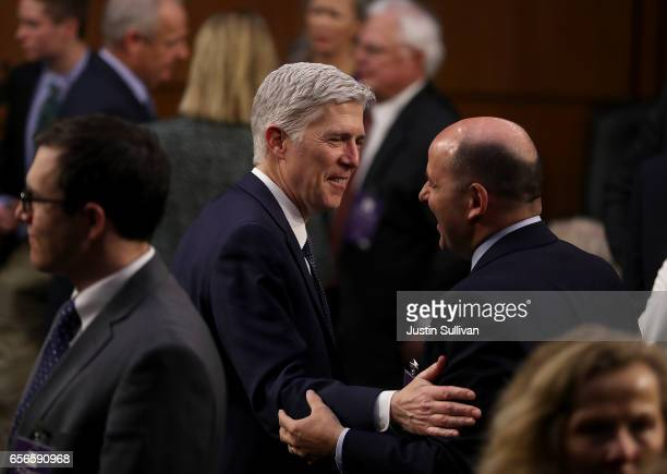 Judge Neil Gorsuch greets an attendee during the third day of his Supreme Court confirmation hearing before the Senate Judiciary Committee in the...