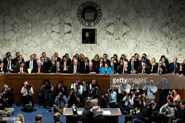 Judge Neil Gorsuch hugs his wife Marie Louise during the first day of his Supreme Court confirmation hearing before the Senate Judiciary Committee in...