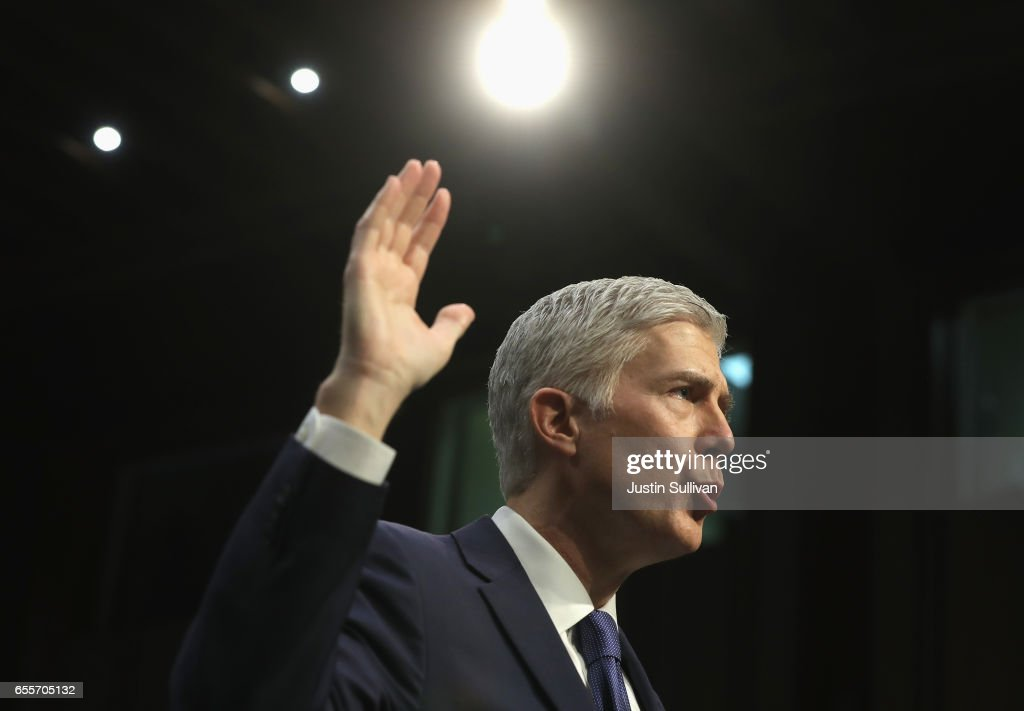 Judge Neil Gorsuch is sworn in on the first day of his Supreme Court confirmation hearing before the Senate Judiciary Committee in the Hart Senate Office Building on Capitol Hill March 20, 2017 in Washington, DC. Gorsuch was nominated by President Donald Trump to fill the vacancy left on the court by the February 2016 death of Associate Justice Antonin Scalia.