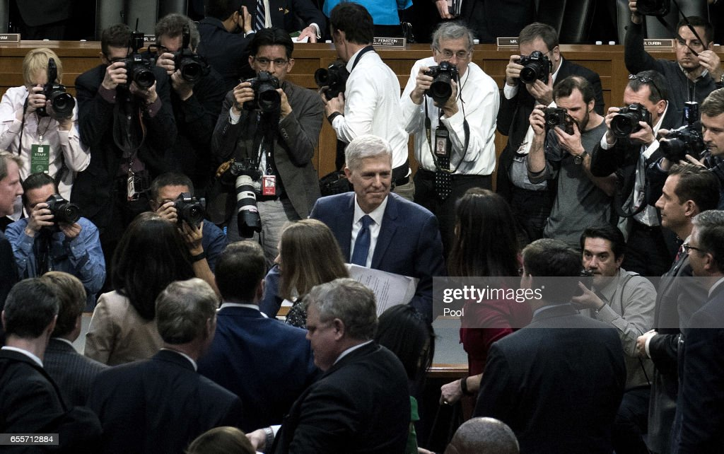 Judge Neil Gorsuch (C) leaves after his first day of his Supreme Court confirmation hearing before the Senate Judiciary Committee in the Hart Senate Office Building on Capitol Hill March 20, 2017 in Washington, DC. Gorsuch was nominated by President Donald Trump to fill the vacancy left on the court by the February 2016 death of Associate Justice Antonin Scalia.
