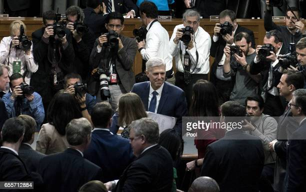 Judge Neil Gorsuch leaves after his first day of his Supreme Court confirmation hearing before the Senate Judiciary Committee in the Hart Senate...