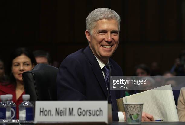 Judge Neil Gorsuch listens during the first day of his Supreme Court confirmation hearing before the Senate Judiciary Committee in the Hart Senate...