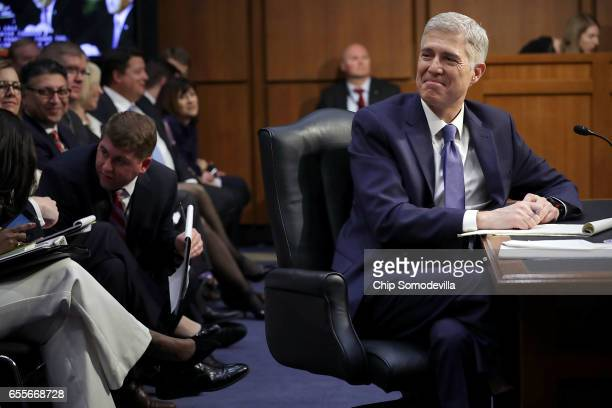 Judge Neil Gorsuch listens to senators' opening statements during first day of his Supreme Court confirmation hearing before the Senate Judiciary...