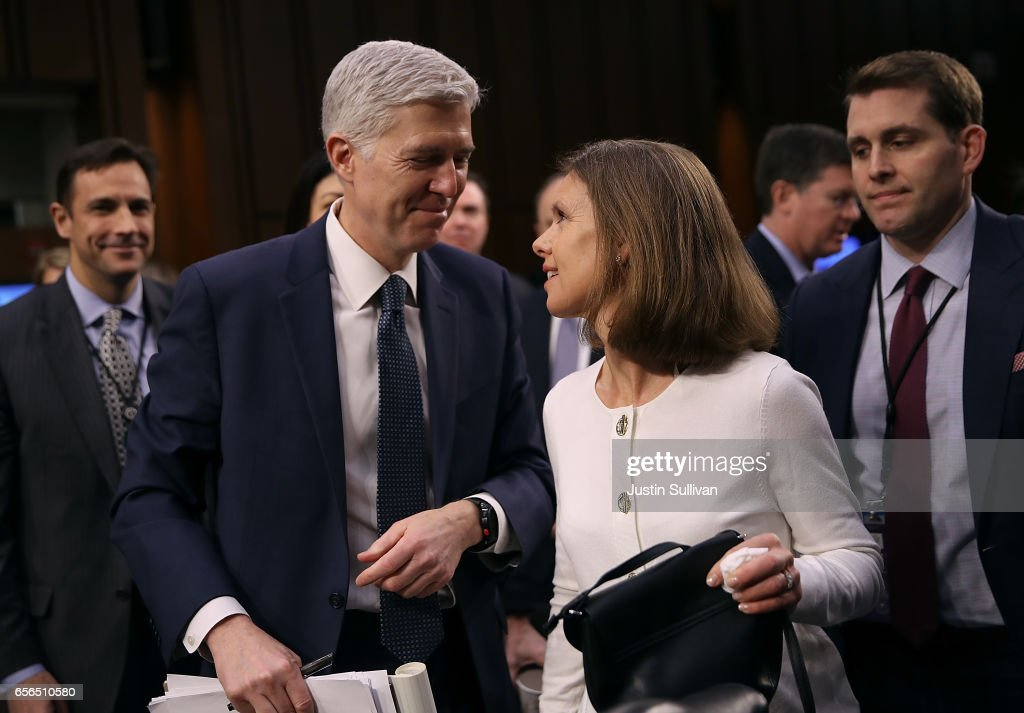 Judge Neil Gorsuch (L) talks with his wife Marie Louise Gorsuch (R) during the third day of his Supreme Court confirmation hearing before the Senate Judiciary Committee in the Hart Senate Office Building on Capitol Hill, March 22, 2017 in Washington. Gorsuch was nominated by President Donald Trump to fill the vacancy left on the court by the February 2016 death of Associate Justice Antonin Scalia.