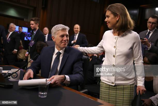 Judge Neil Gorsuch talks with his wife Marie Louise Gorsuch during the third day of his Supreme Court confirmation hearing before the Senate...