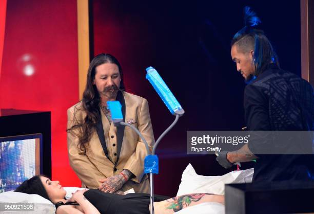 Judge Oliver Peck observes as Anthony Michaels competes during the Ink Master Season 10 Finale at the Park Theater at Monte Carlo Resort and Casino...
