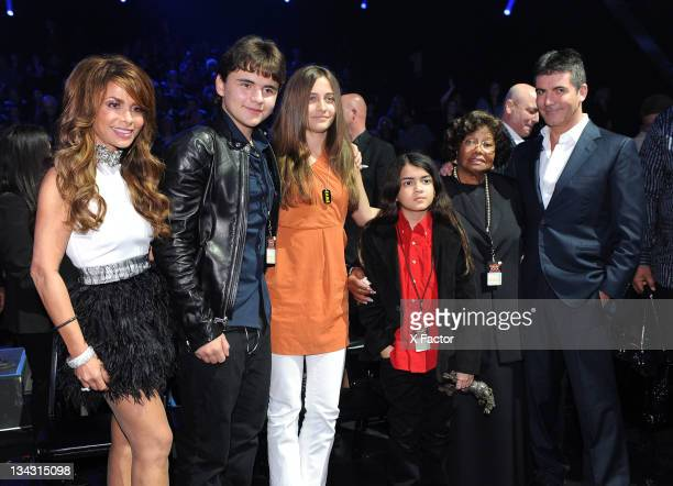 Judge Paula Abdul and Michael Jackson's children Prince Jackson Paris Jackson and Blanket Jackson mother Katherine Jackson and judge Simon Cowell in...