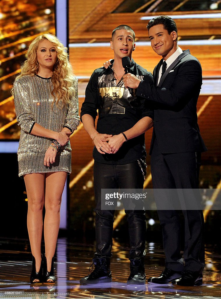 Judge Paulina Rubio (L), eliminated contestant Carlito Olivero and host Mario Lopez onstage on FOX's 'The X Factor' Season 3 Live Finale on December 19, 2013 in Hollywood, California.