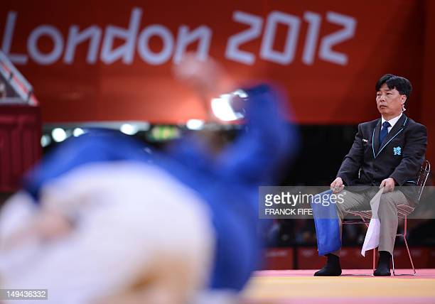 A judge prepares to give his decision at the end of a combat of the men's 60 kgs contest of the judo event at the London 2012 Olympic Games on July...