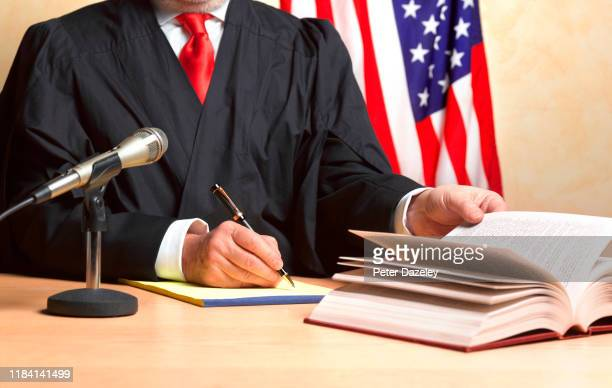 judge referring to book during summing up - chairperson stock pictures, royalty-free photos & images