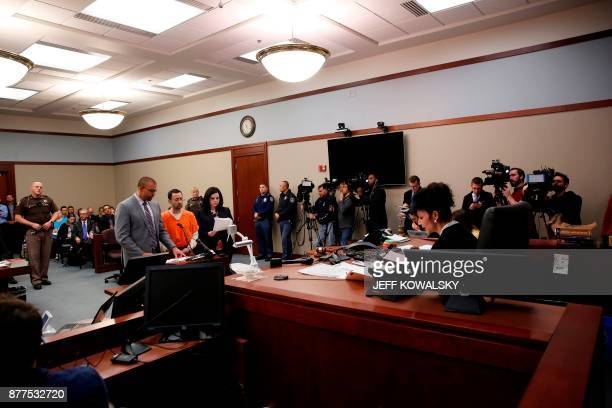 Judge Rosemarie Aquilina addresses former Michigan State University and USA Gymnastics doctor Larry Nassar flanked by defense attorneys Matt Newberg...