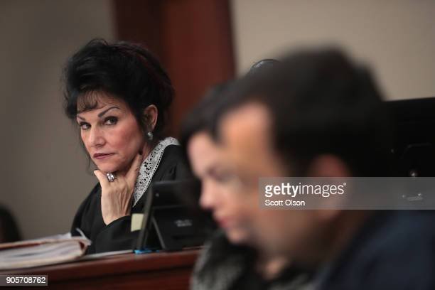 Judge Rosemarie Aquilina looks at Larry Nassar as he listens to a victim's impact statement by Jennifer Rood Bedford prior to being sentenced after...
