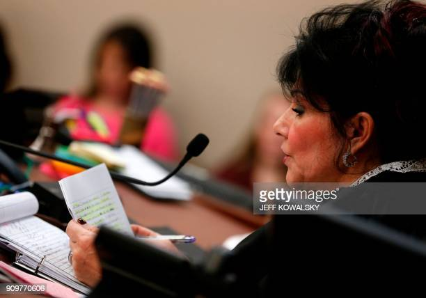 Judge Rosemarie Aquilina reads a letter from former Michigan State University and USA Gymnastics doctor Larry Nassar during the sentencing phase in...