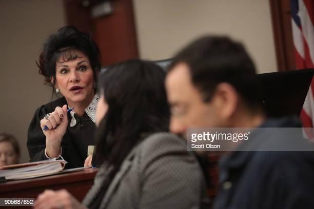 Judge Rosemarie Aquilina speaks with Larry Nassar and his attorney Shannon Smith as he appears in court to listen to victim impact statements prior...