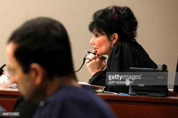 Judge Rosemarie Aquilina watches as Former Michigan State University and USA Gymnastics doctor Larry Nassar listens to impact statements during the...