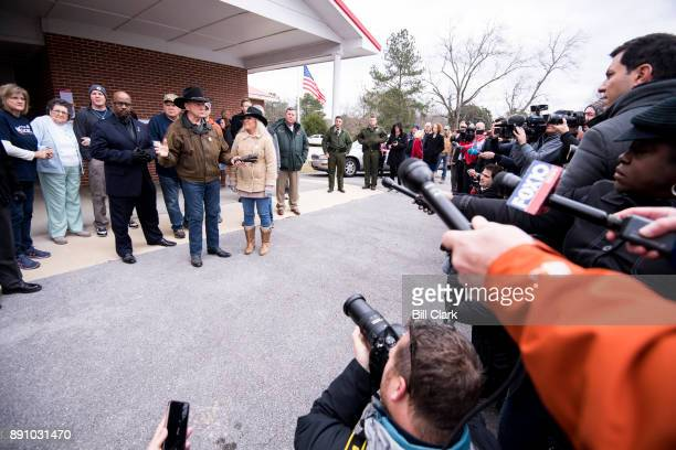Judge Roy Moore speaks to the media with his wife Kayla at his side after voting at the Gallant Volunteer Fire Department in Gallant Ala on Tuesday...