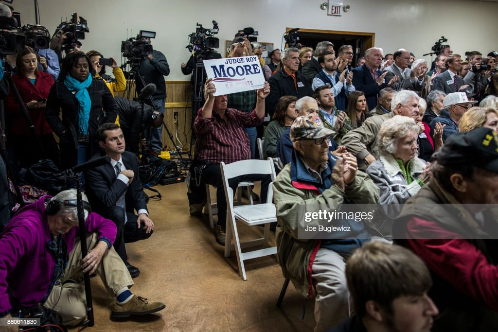 Judge Roy Moore supporters listen during a campaign rally on November 27, 2017 in Henagar, Alabama. Over 100 people turned out to the event packing the Henagar Event Center.