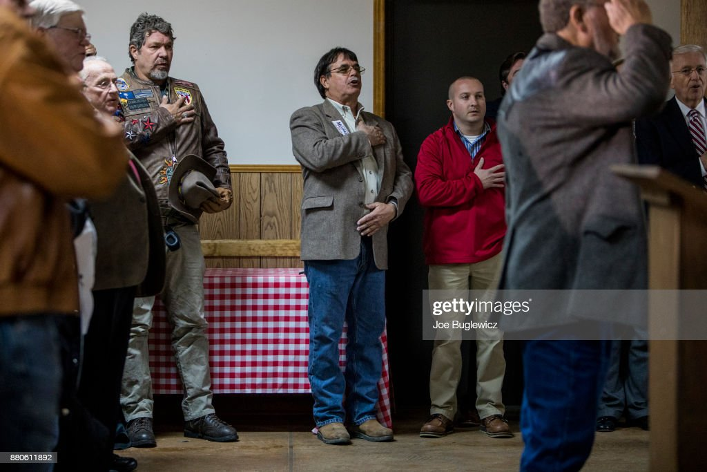 Judge Roy Moore supporters say The Pledge of Allegiance during a campaign rally on November 27, 2017 in Henagar, Alabama. Over 100 people turned out to the event packing the Henagar Event Center.
