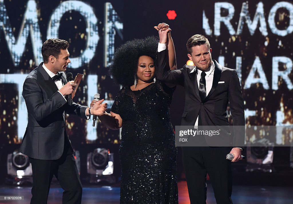 Judge Ryan Seacrest (L) announces American Idol Season 15 winner Trent Harmon (R) with runner-up La'Porsha Renae, onstage at FOX's American Idol Season 15 Finale on April 7, 2016 at the Dolby Theatre in Hollywood, California.