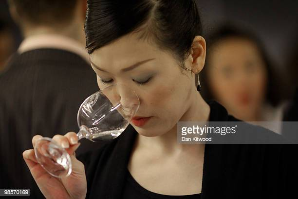 A judge samples a Sake wine during the 'International Wine Challenge' event at the Barbican centre on April 20 2010 in London England Judges will...