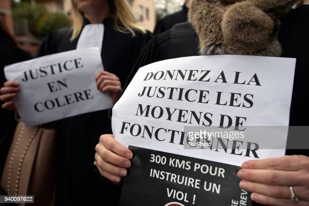 A judge shows a placard reading 'Give Justice the means to operate'The French Bar Association all lawyers' unions all magistrates' unions called all...