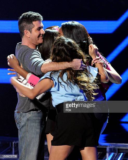 Judge Simon Cowell and contestant Fifth Harmony onstage at FOX's 'The X Factor' Season 2 Top 13 To 12 Live Elimination Show on November 8 2012 in...