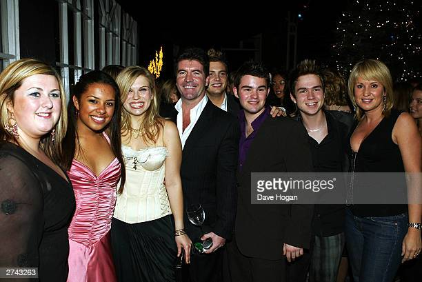 Judge Simon Cowell and remaining contestants from Pop Idol Michelle Mcmanus Roxanne Cooper Susanne Manning Mark Rhodes Chris Hide Sam Nixon and...
