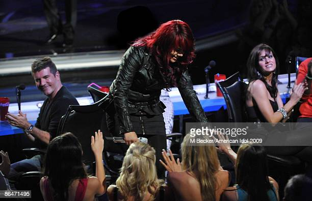 ACCESS*** Judge Simon Cowell contestant Allison Iraheta and judge Kara DioGuardi live on the American Idol Season 8 Top 4 Elimination Show on May 6...