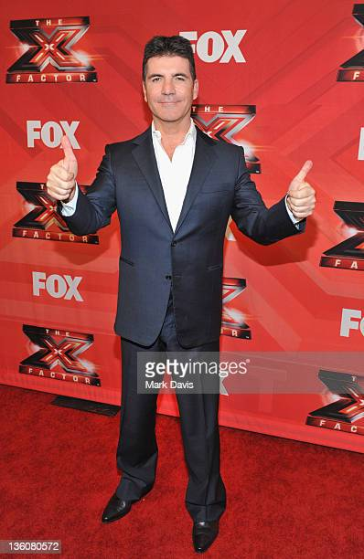 """Judge Simon Cowell poses at Fox Television's """"The X Factor"""" Season Finale at CBS Television City on December 22, 2011 in Los Angeles, California."""