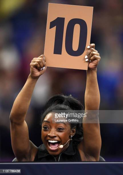 Judge Simone Biles of the USA awards Ellie Black of Canada a '10' for her Vault during the Superstars of Gymnastics at The O2 Arena on March 23 2019...