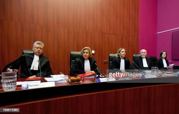 Judge SM van Lieshout chairman of the court A van Holten and judge FH Schormans Registrar Mr E R Ruitenbeek and Registrar Mrs S J Verheij De Vries...