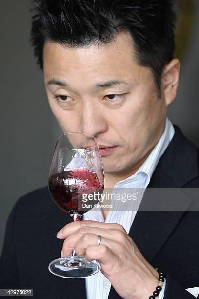 A judge tastes a red wine at the 'International Wine Challenge' event at Lords Cricket ground on April 16 2012 in London England Judges will taste...