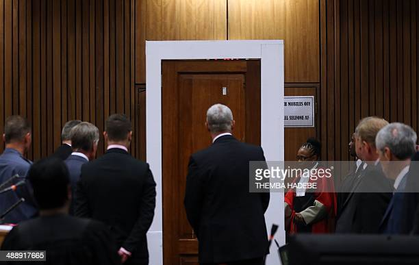 """Judge Thokozile Masipa examines evidences during the Tom """"Wollie"""" Wolmarans, a retired South African Police Service forensics expert, testimony at..."""