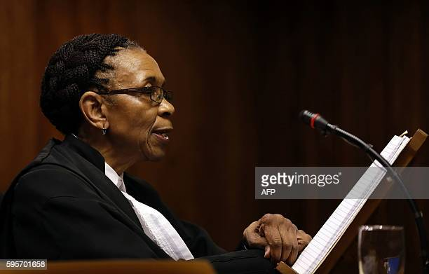 Judge Thokozile Masipa reads her verdict during the state appeal hearing at the high court in Johannesburg, on August 26, 2016 as the State...