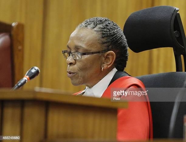 Judge Thokozile Masipa reads part of her verdict during the murder trial of paralympic athlete Oscar Pistorius in the Pretoria High Court on...
