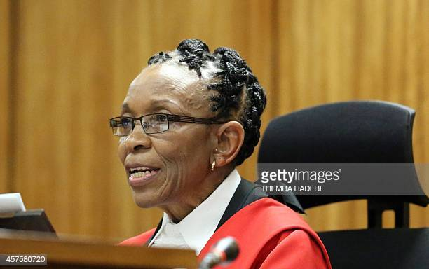 Judge Thokozile Masipais, reads her judgement against South African Paralympic athlete Oscar Pistorius at the High Court in Pretoria, on October 21,...