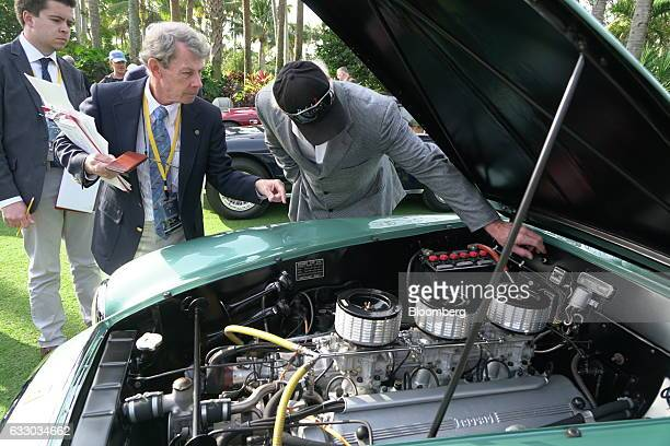 Judge views the engine of a 1952 Ferrari SpA 342 America grand touring vehicle during the 26th Annual Cavallino Classic Event at the Breakers Hotel...