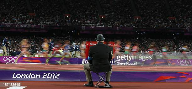 A judge watches over the women's 10000 metres during the athletic events at the London 2012 Olympic Games at the Olympic Stadium
