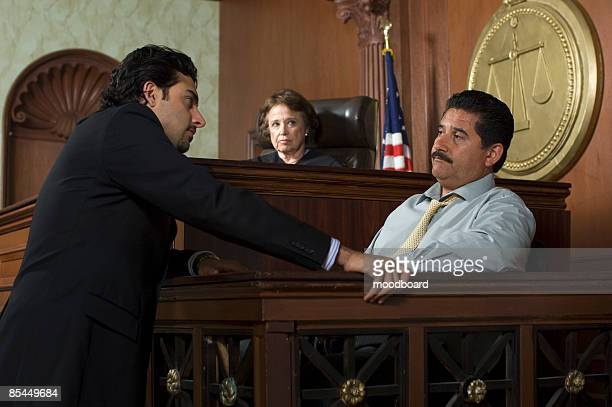 judge watching prosecution in court - legal defense stock pictures, royalty-free photos & images