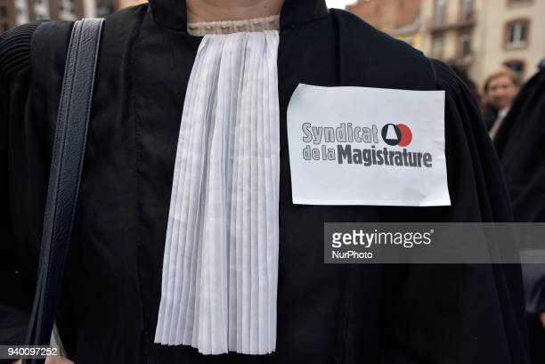A judge wears a sticker of the 'Magistrate Union' The French Bar Association all lawyers' unions all magistrates' unions called all its members to be...