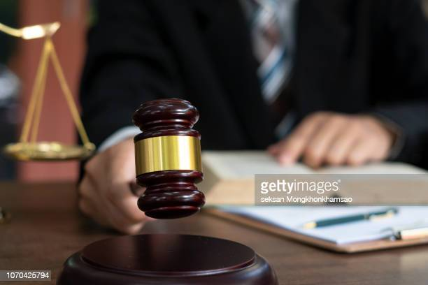 judge with gavel on table. attorney, court judge,tribunal and justice concept. - crime or recreational drug or prison or legal trial stock-fotos und bilder