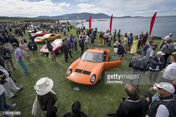 Judges and attendees view the 1968 Lamborghini Miura P400 Bertone Coupe during the 2019 Pebble Beach Concours d'Elegance in Pebble Beach, California,...