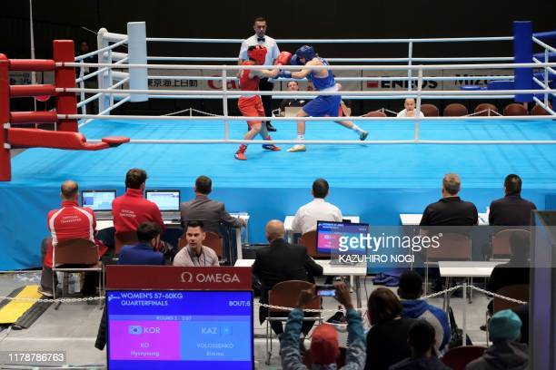 Judges and boxing match operators watch a test event at Kokugikan Arena, a venue of the Tokyo 2020 Olympic Games, in Tokyo on October 29, 2019.