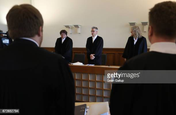 Judges and lawyers arrive for the first day of a legal appeal by a woman against Facebook at the Kammergericht courthouse on April 25 2017 in Berlin...